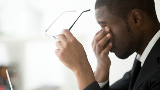 Man rubbing eyes requiring Fatigue Treatment in Downers Grove IL