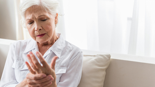 Elderly woman holding hand requiring Natural remedies for joint pain in Clarendon Hills IL