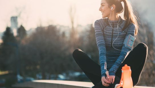 Woman taking a break after running, as part of a healthier lifestyle and Integrative Medicine
