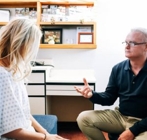 Doctor offering Functional Medicine in Hinsdale IL to a female patient